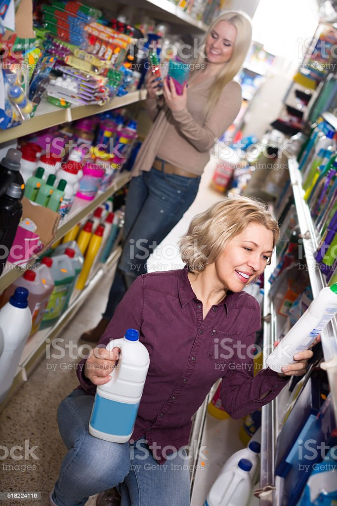 Women buying detergents stock photo
