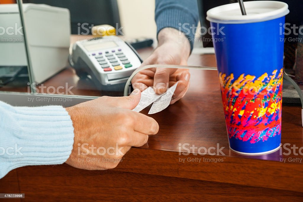 Women Buying Movie Tickets At Box Office stock photo