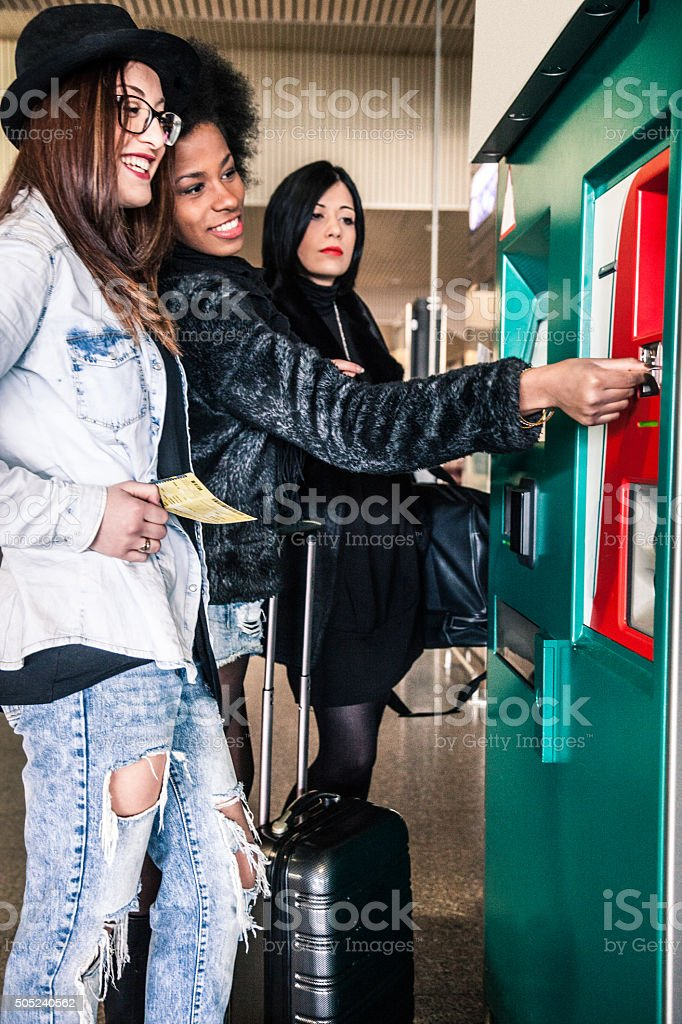 Women buying tickets for the train stock photo