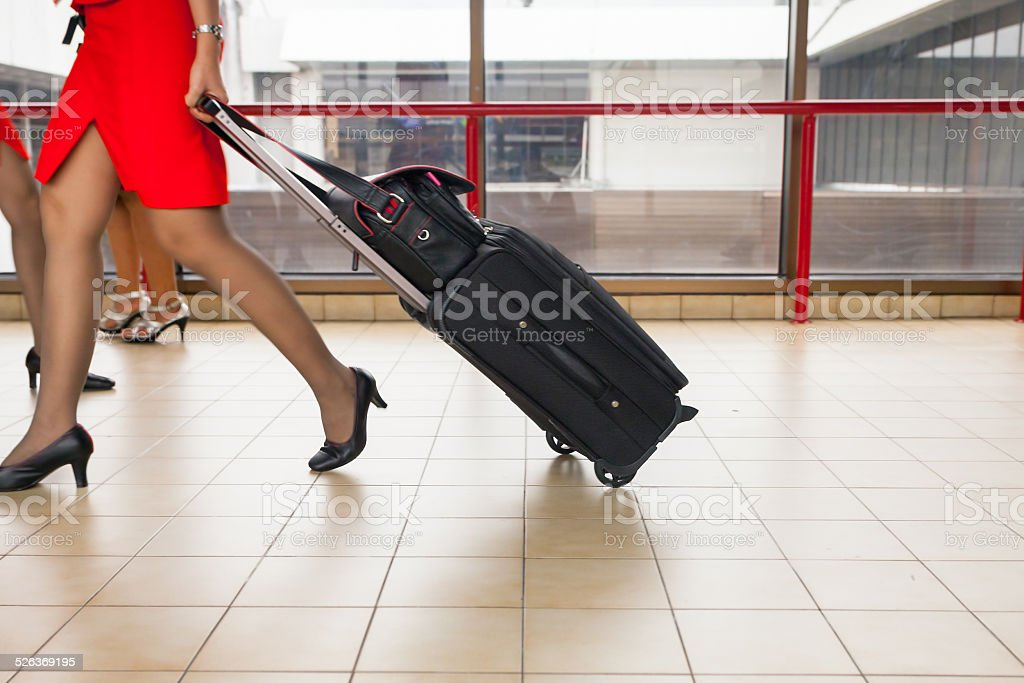 Women carries their luggage at the airport stock photo