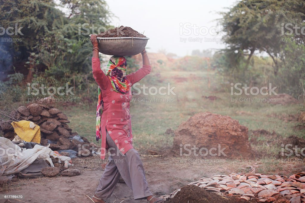 Women carrying fertilizer of Shallowpan stock photo