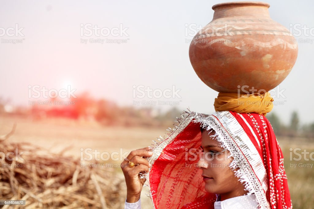Women carrying water pot portrait outdoor stock photo