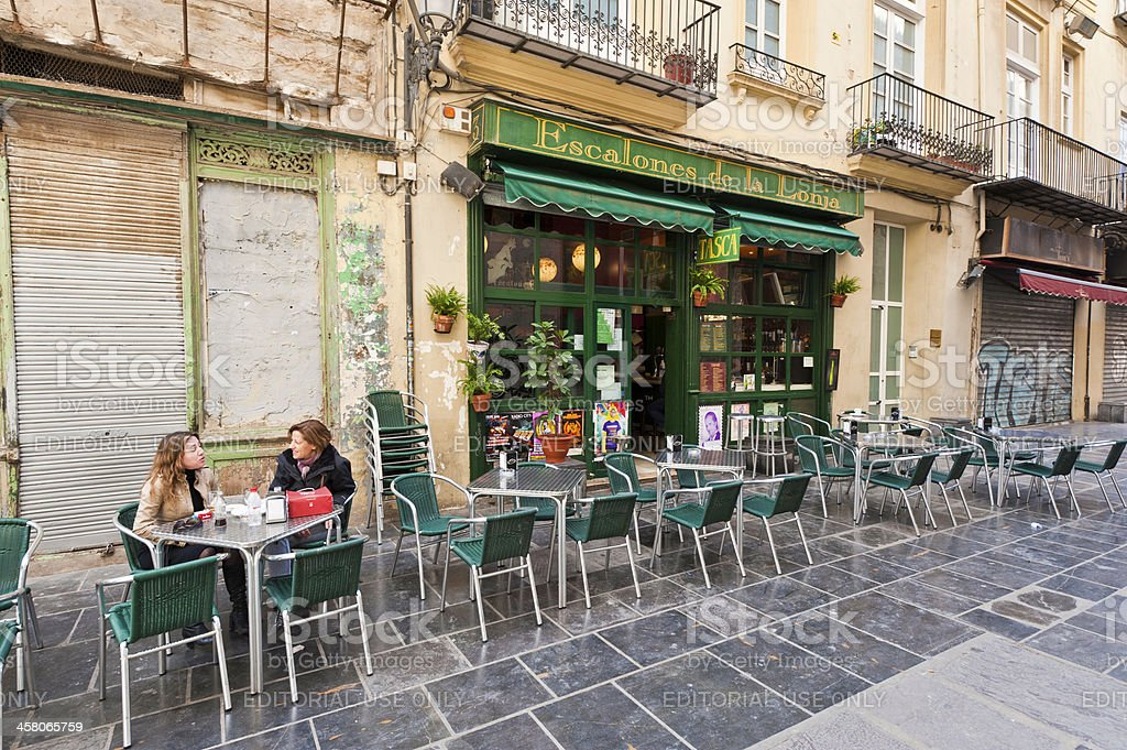 Women chatting at pavement cafe tables Valencia Spain royalty-free stock photo
