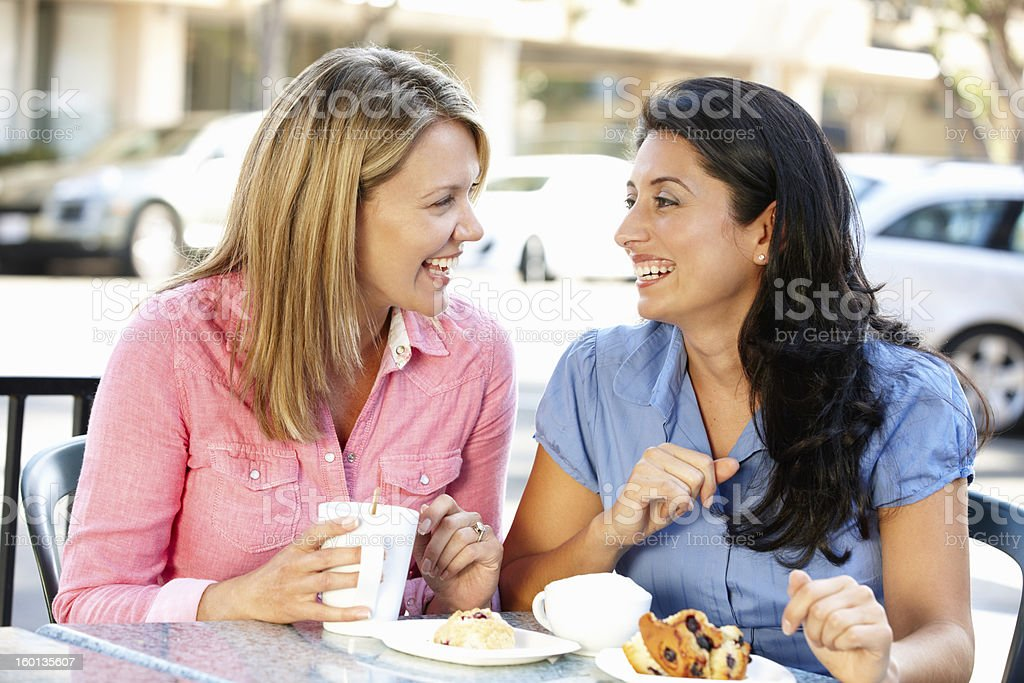 Women chatting over coffee and cakes royalty-free stock photo