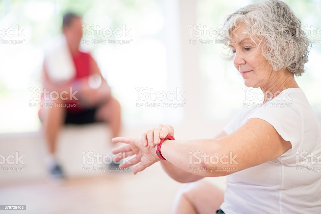 Women Checking Her Heart Rate stock photo