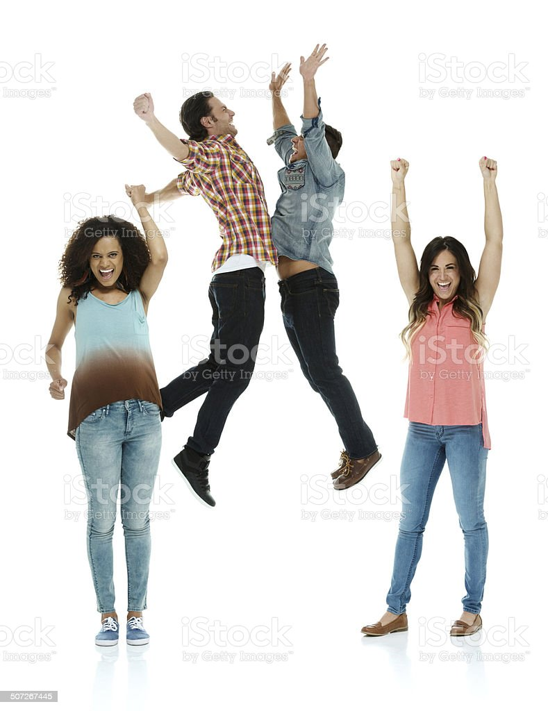 Women cheering & men doing a chest bump stock photo