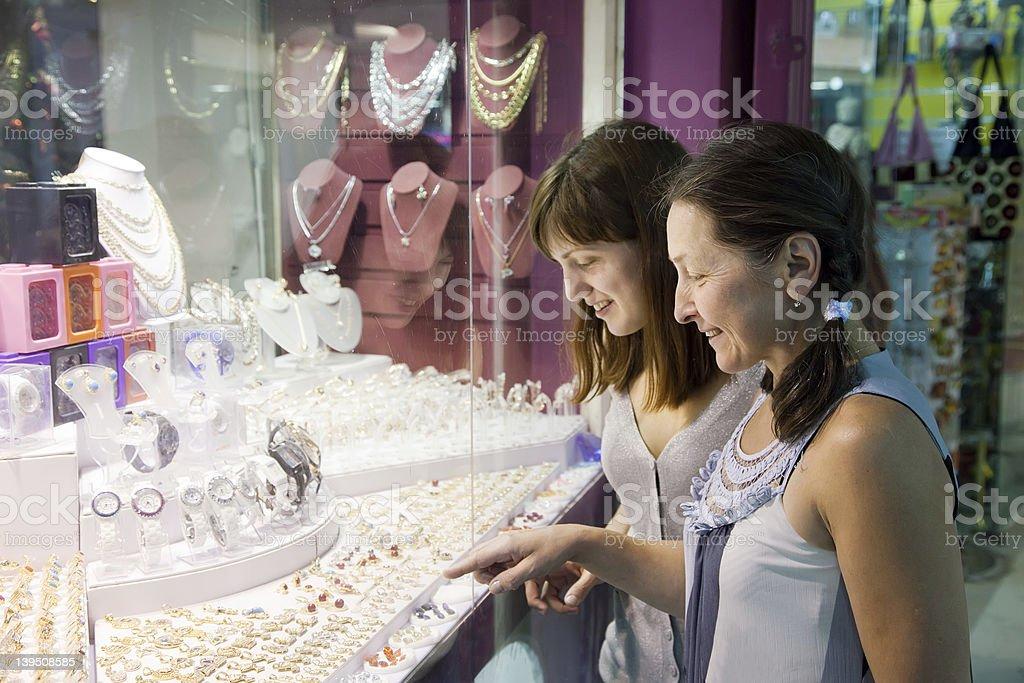 women chooses jewelry stock photo