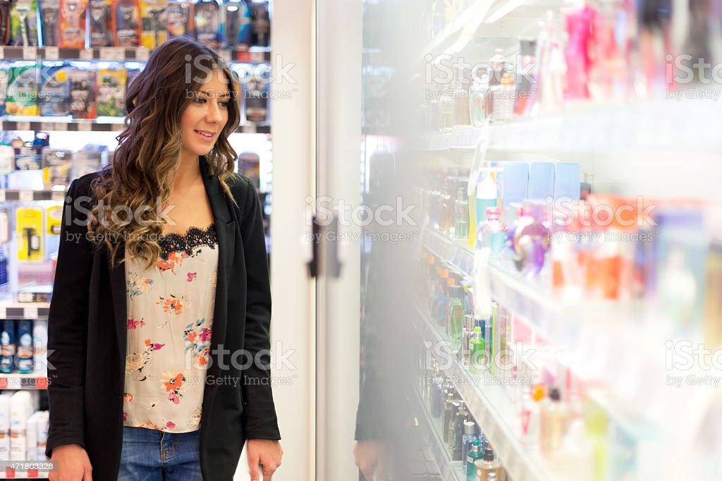 Women choosing parfume in shopping mall stock photo