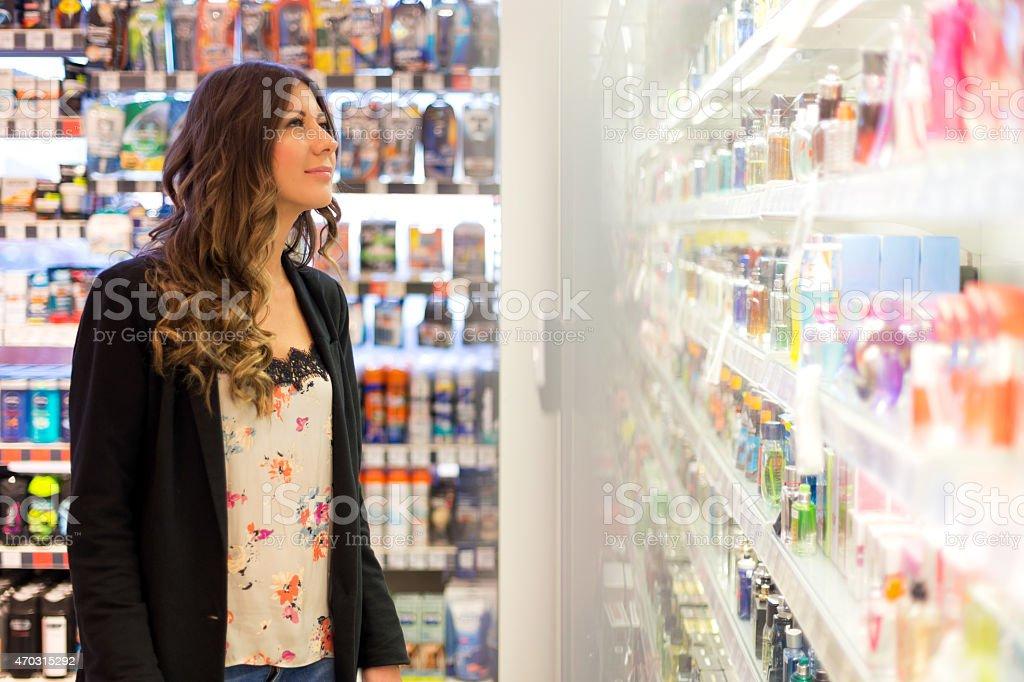 Women choosing parfume in store stock photo