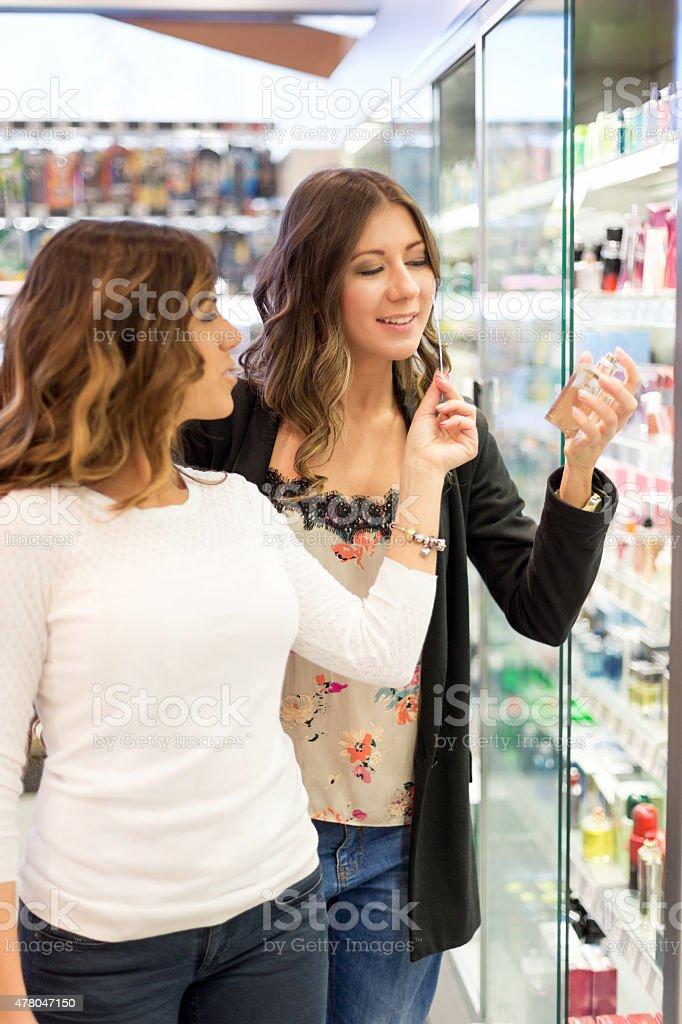Women choosing perfume stock photo
