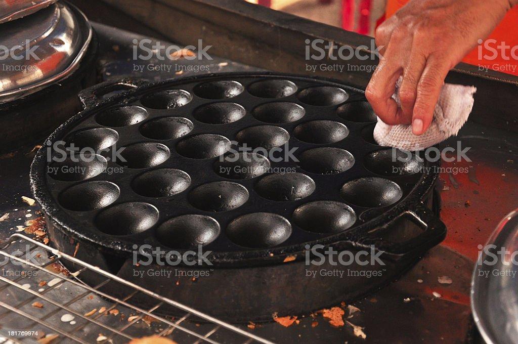 women cleaned the Kanom Krok pan , Dessert Thai sweet royalty-free stock photo