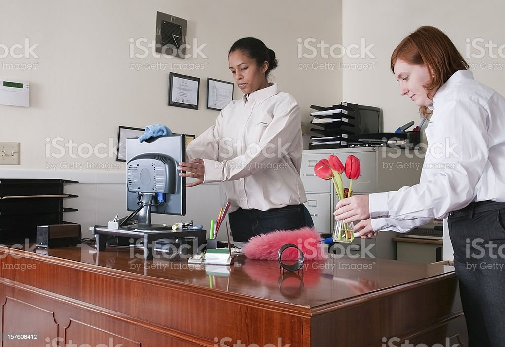 Women Cleaning an Office royalty-free stock photo