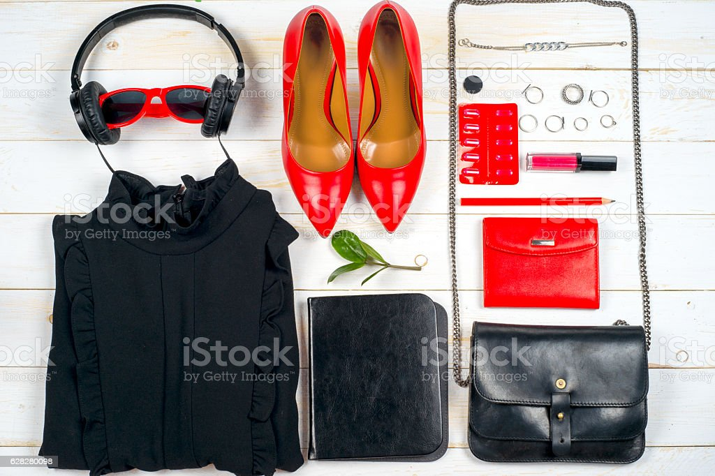 Women clothing set and accessories on white wooden background. stock photo
