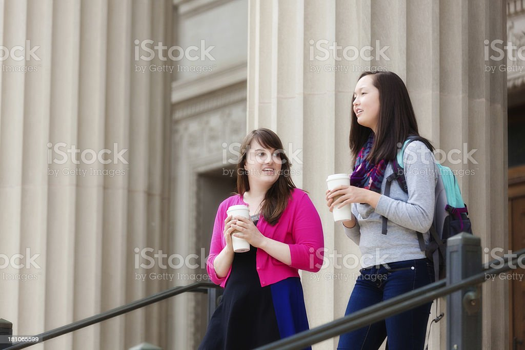Women College Students Walking on Campus to University School Class royalty-free stock photo