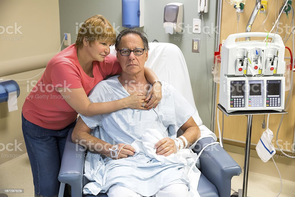 Women comforts her husband in the hospital royalty-free stock photo