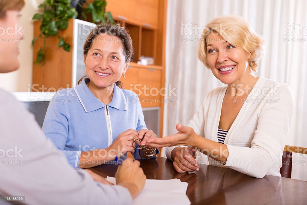 women consulting at insurance agent stock photo