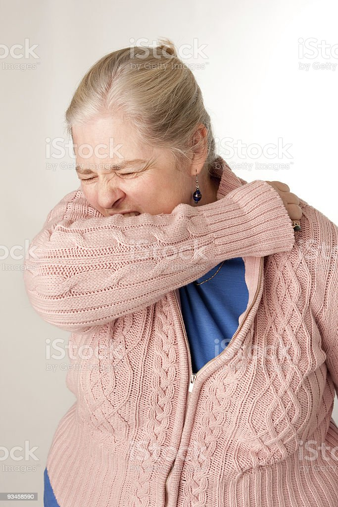 Women Coughing into Elbow royalty-free stock photo