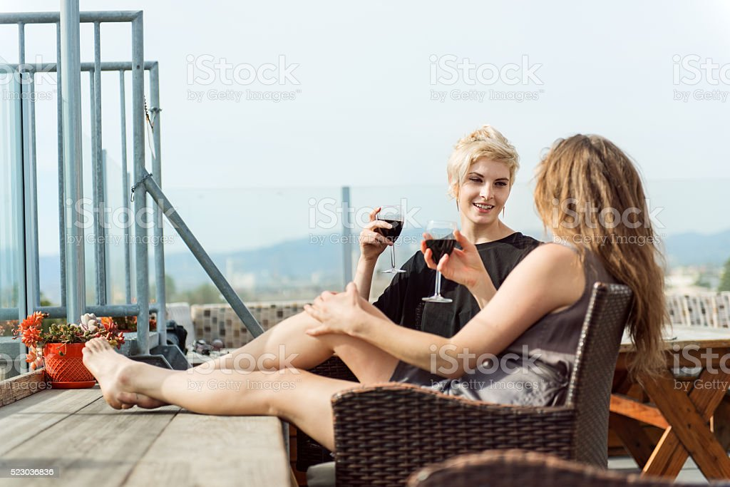 Women couple relaxing on the roof stock photo