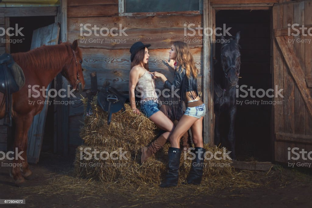 Women cowboys are in conflict. stock photo