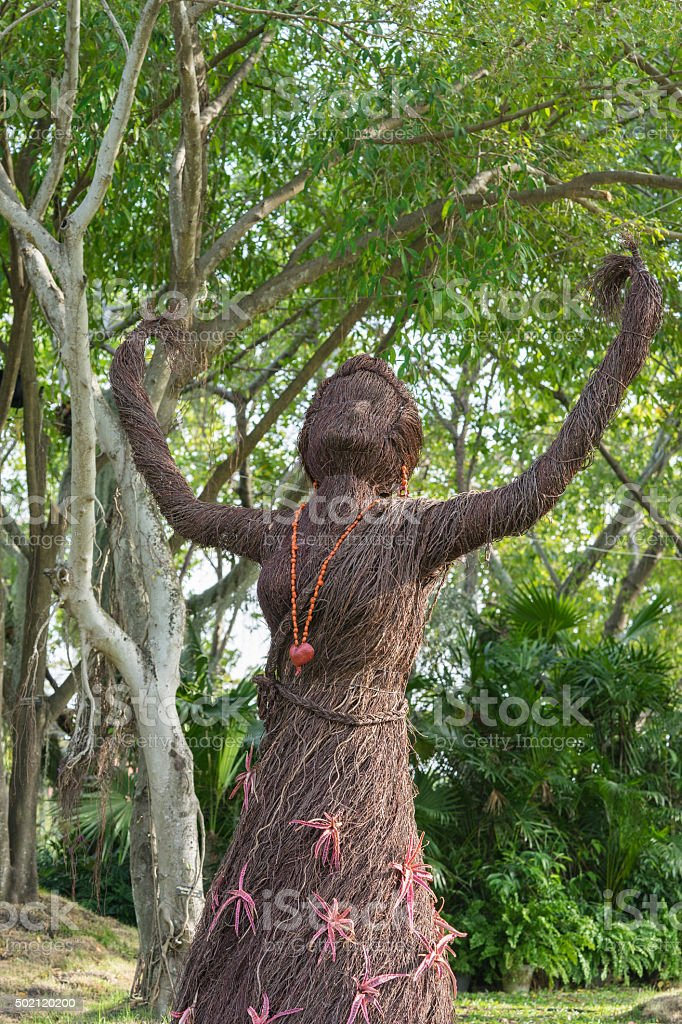 Women create from lianas in garden stock photo