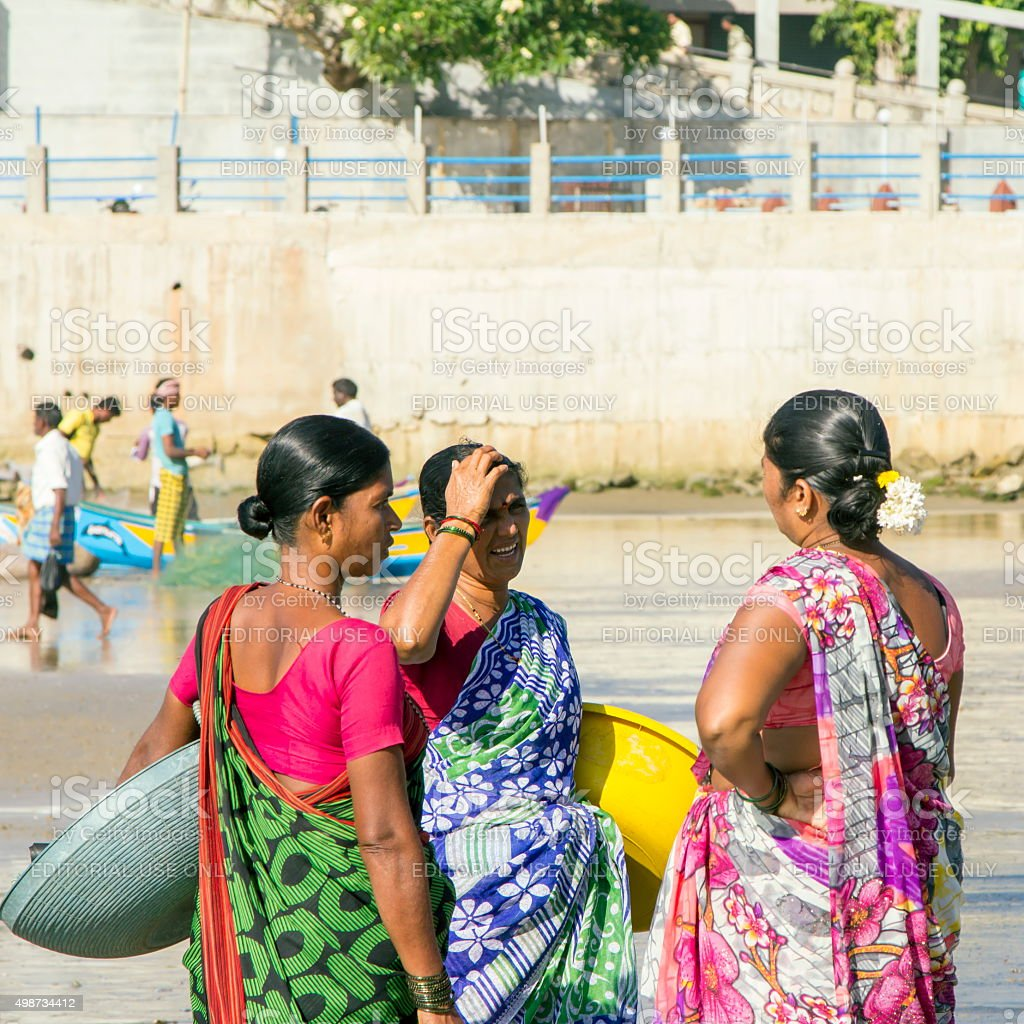 Women customers chat on beach, Murudeshwar, Karnataka, India stock photo