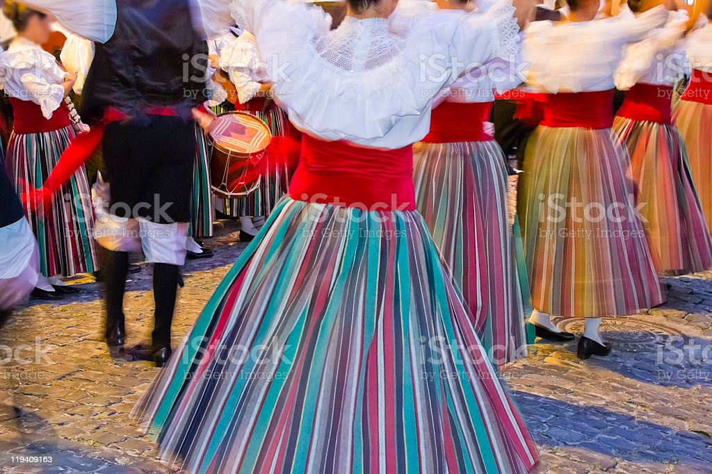 Women dancing in traditional clothing for a celebration stock photo
