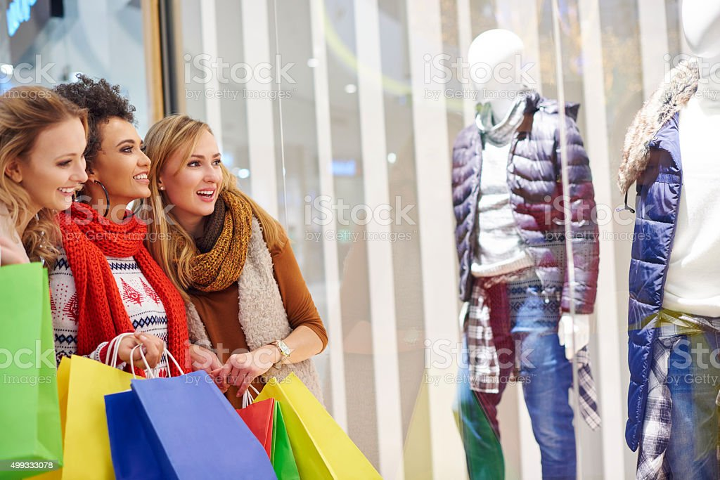 Women delighting over the shop display stock photo