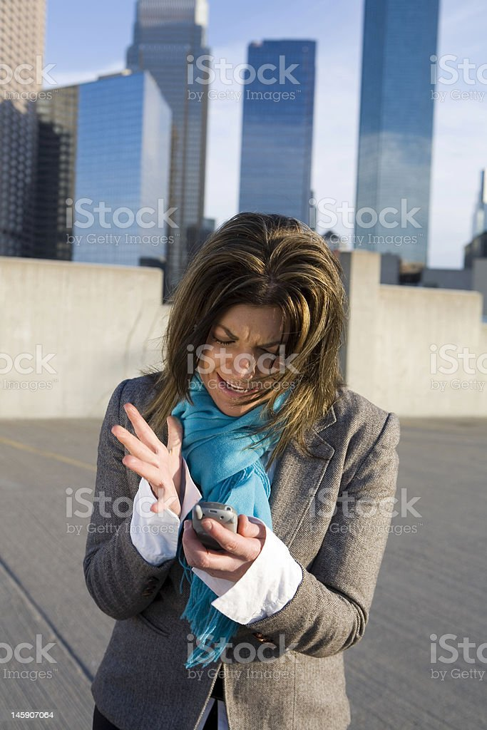 Women Distraught With Cell Phone royalty-free stock photo
