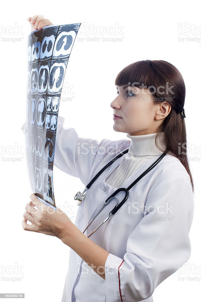 Women doctor watching a patient x-ray royalty-free stock photo
