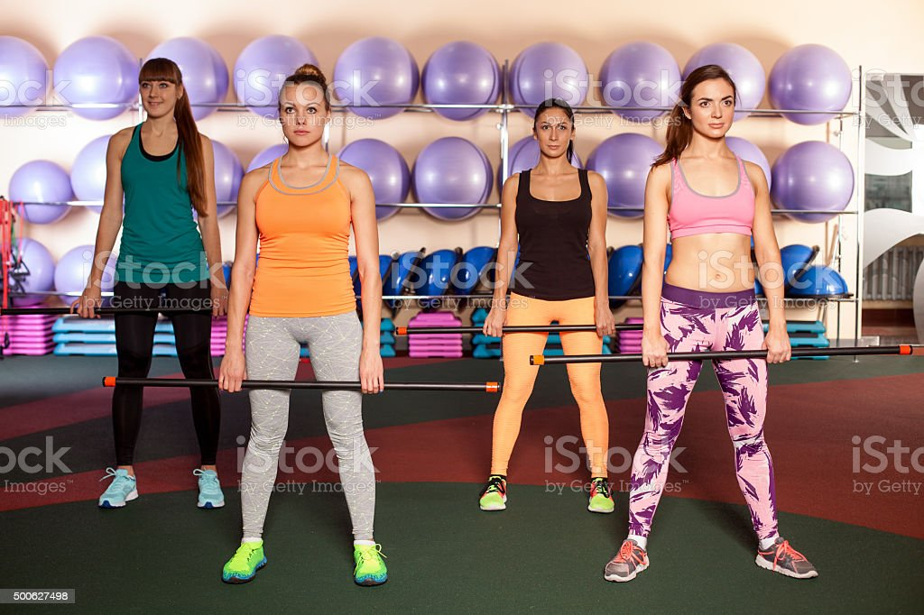 women doing a leg exercise in aerobics class stock photo