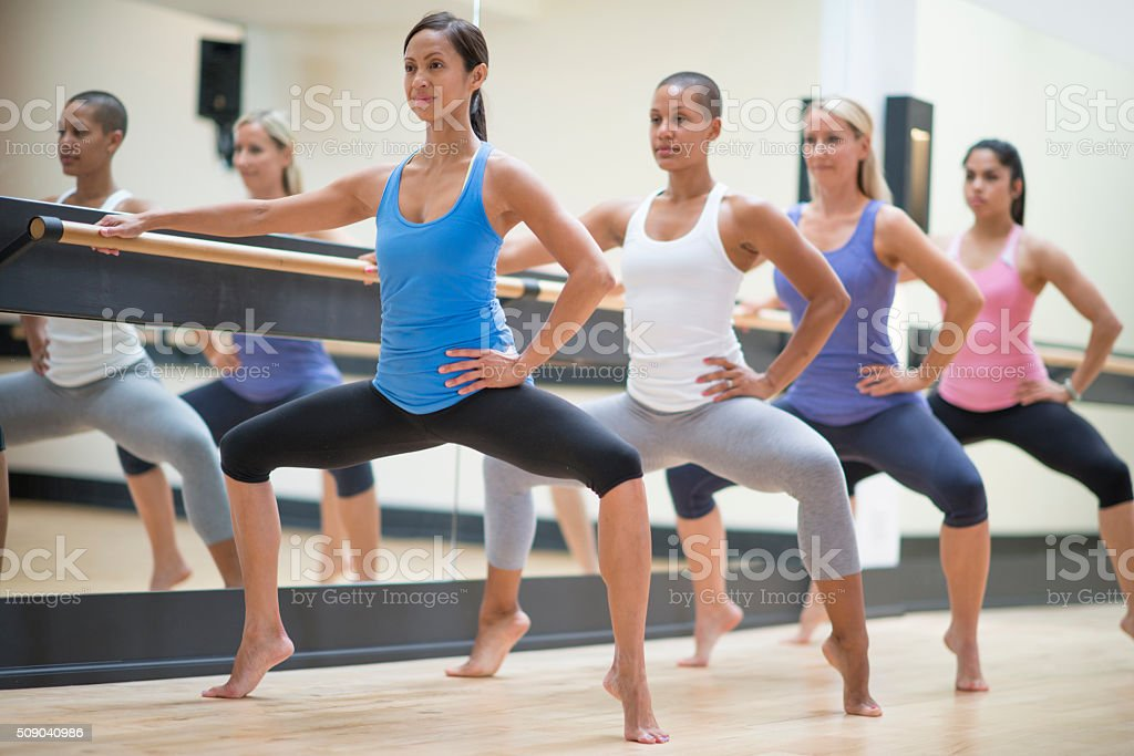 Women Doing a Plie in Ballet stock photo