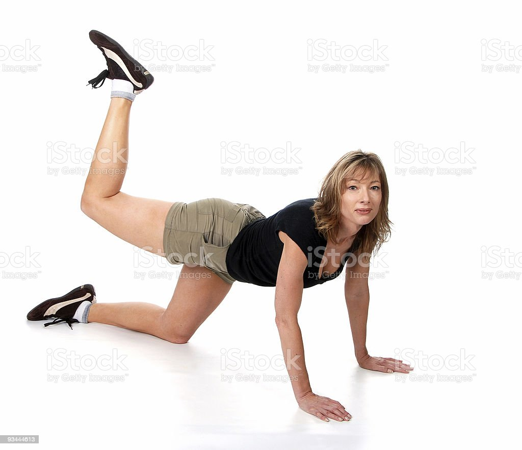women doing back kick excersie royalty-free stock photo
