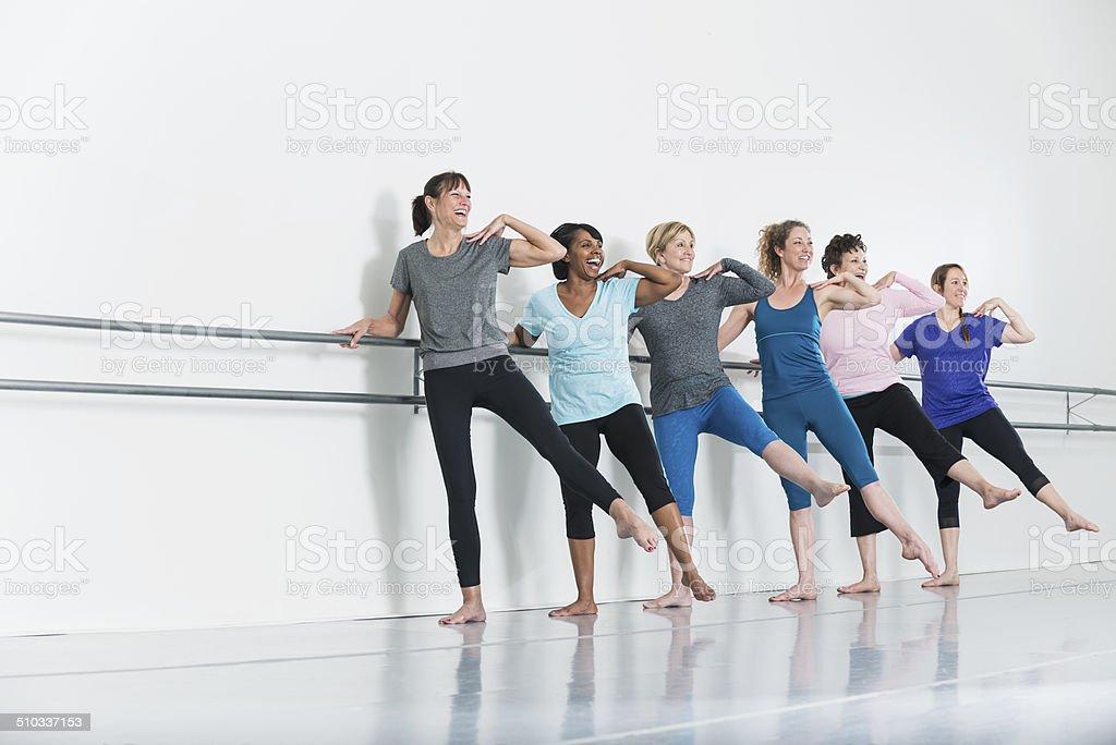 Women doing barre exercises stock photo