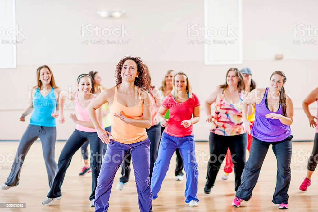 Women Doing Fitness Class Together stock photo