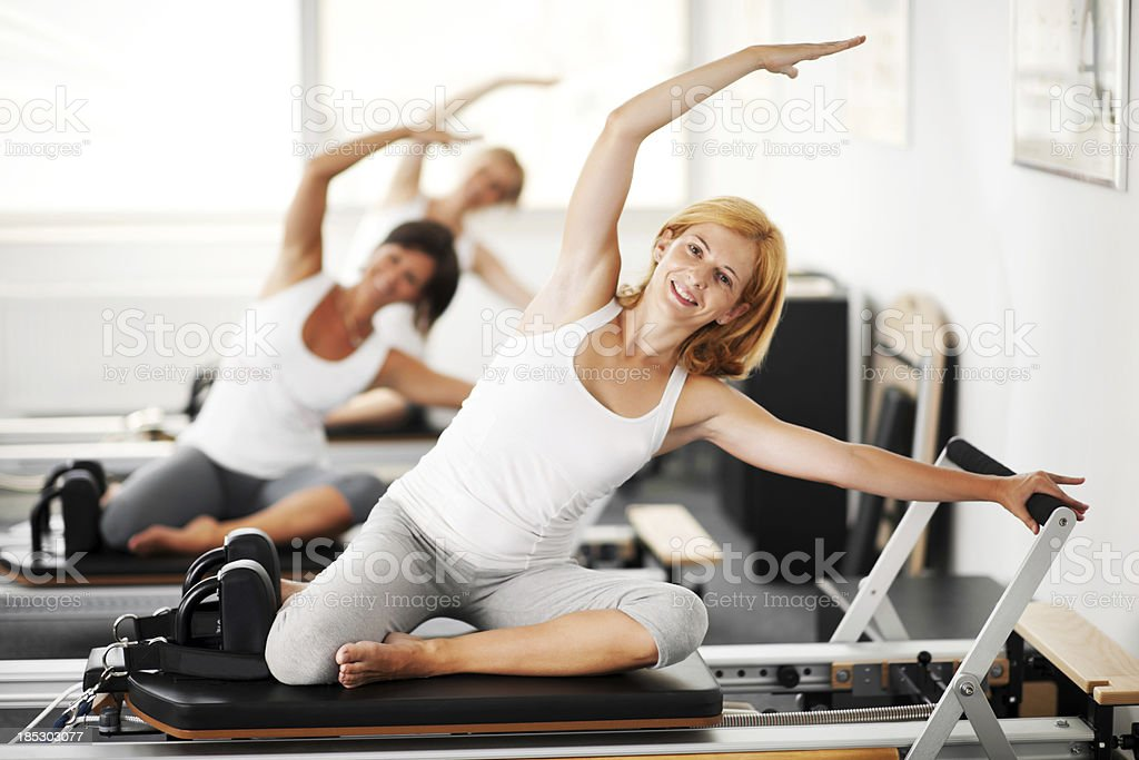 Women doing Pilates exercises stock photo
