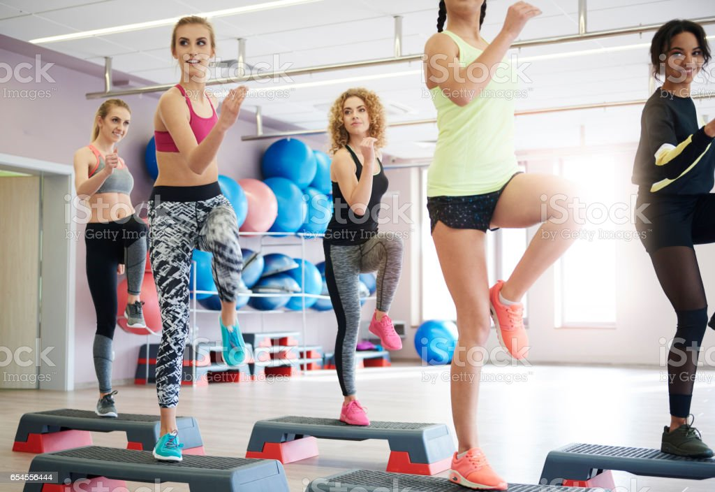 Women doing stepping trainings in group stock photo