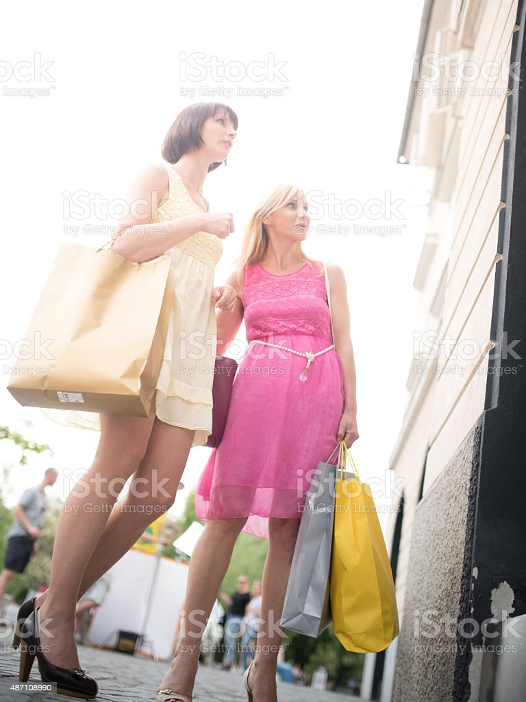 Women doing window shopping stock photo