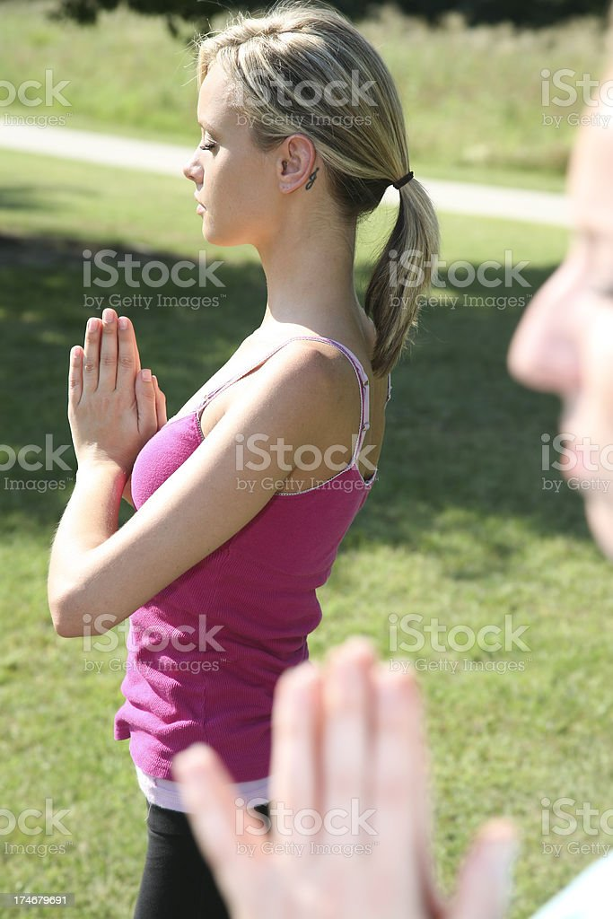 Women Doing Yoga A Stance Outside Together royalty-free stock photo