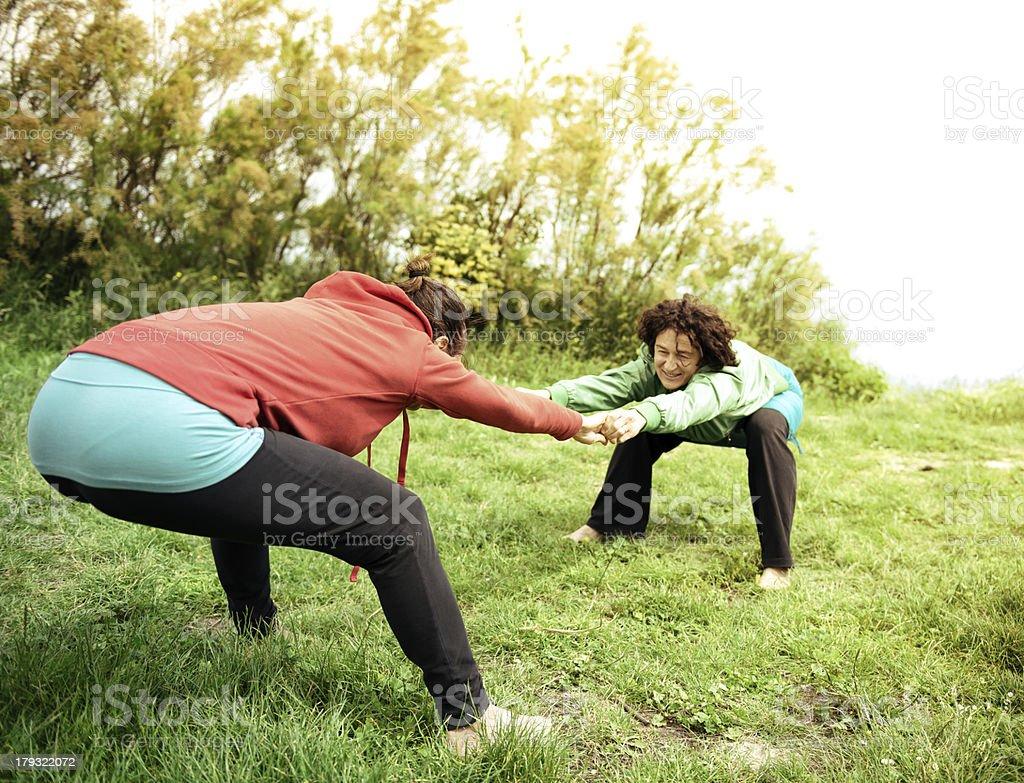 Women doing yoga exercise outdoors stock photo