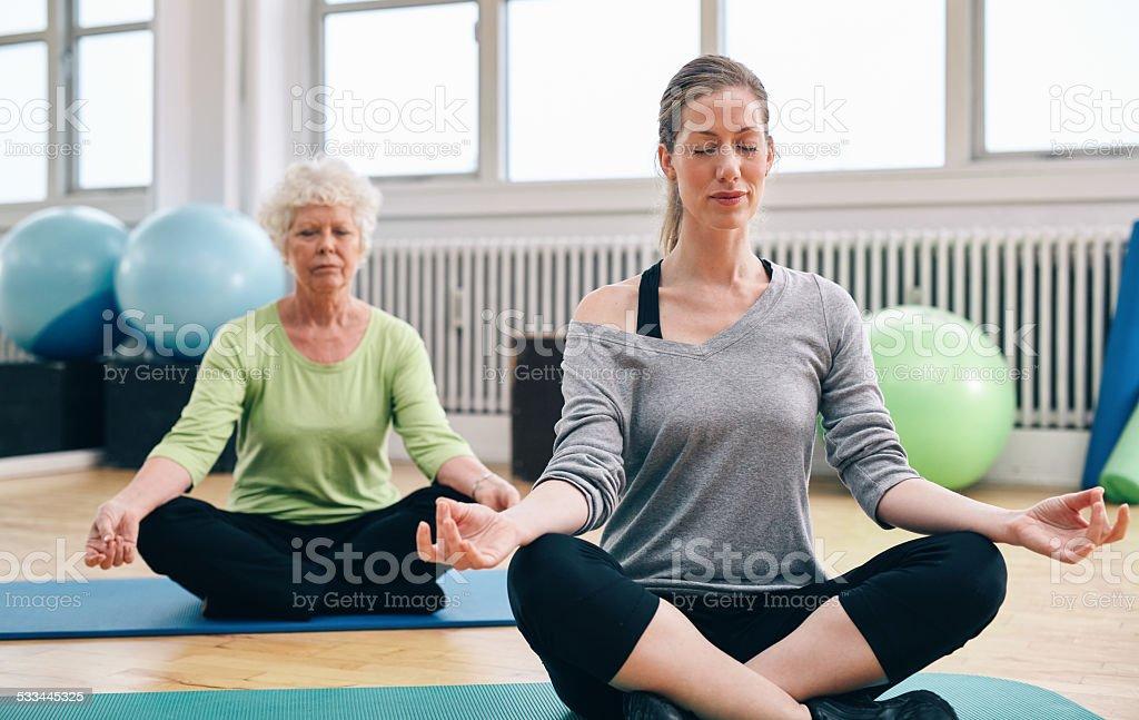 Women doing yoga in class stock photo