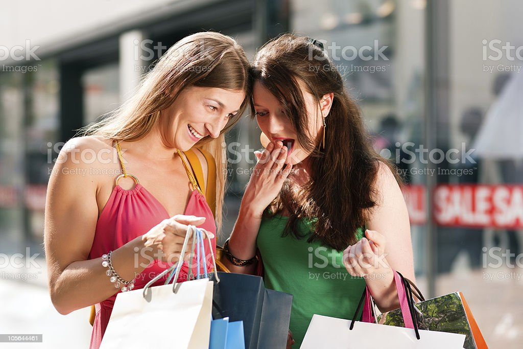 women downtown shopping with bags royalty-free stock photo