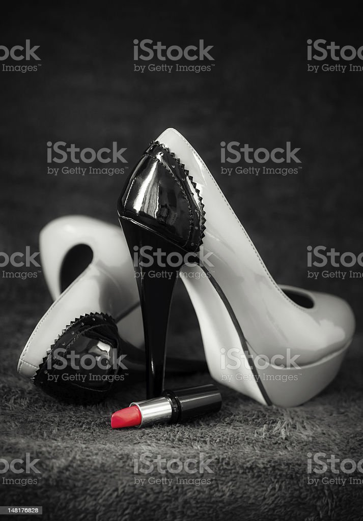 Women dress shoes with lipstick stock photo