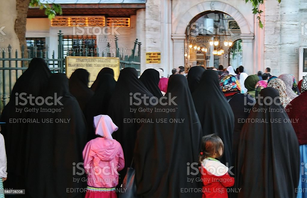 Women dressed with black headscarf, chador on istanbul street, Turkey stock photo