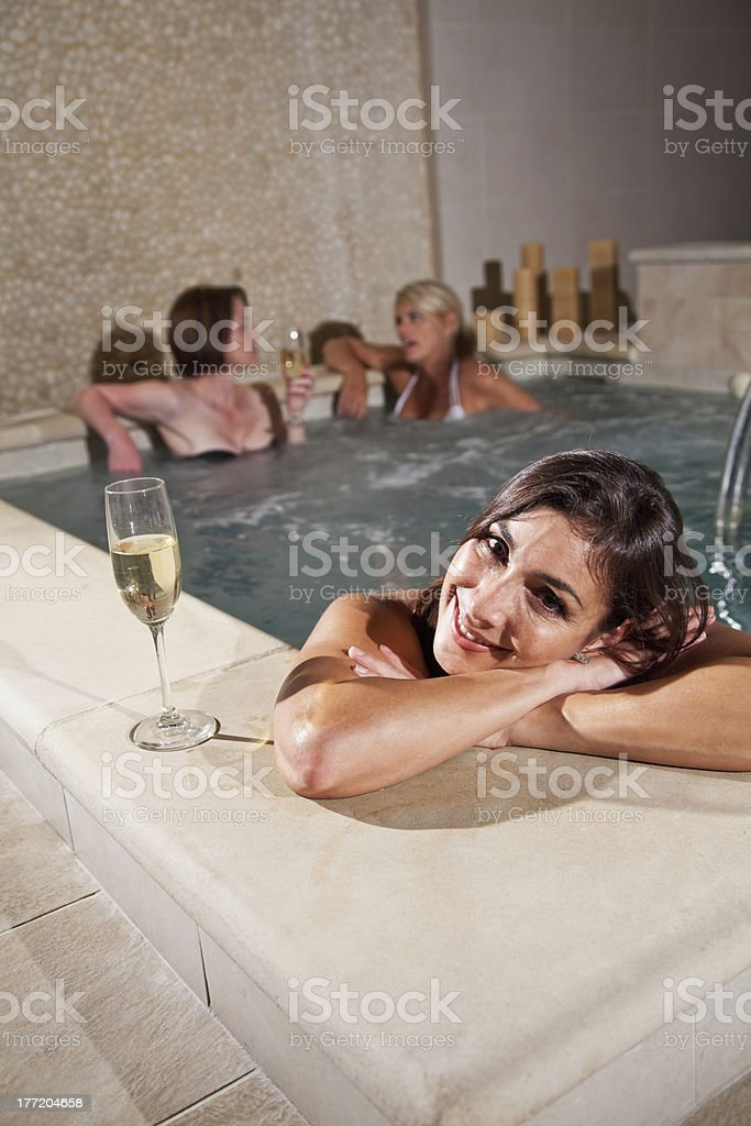 Women drinking champagne in jacuzzi royalty-free stock photo