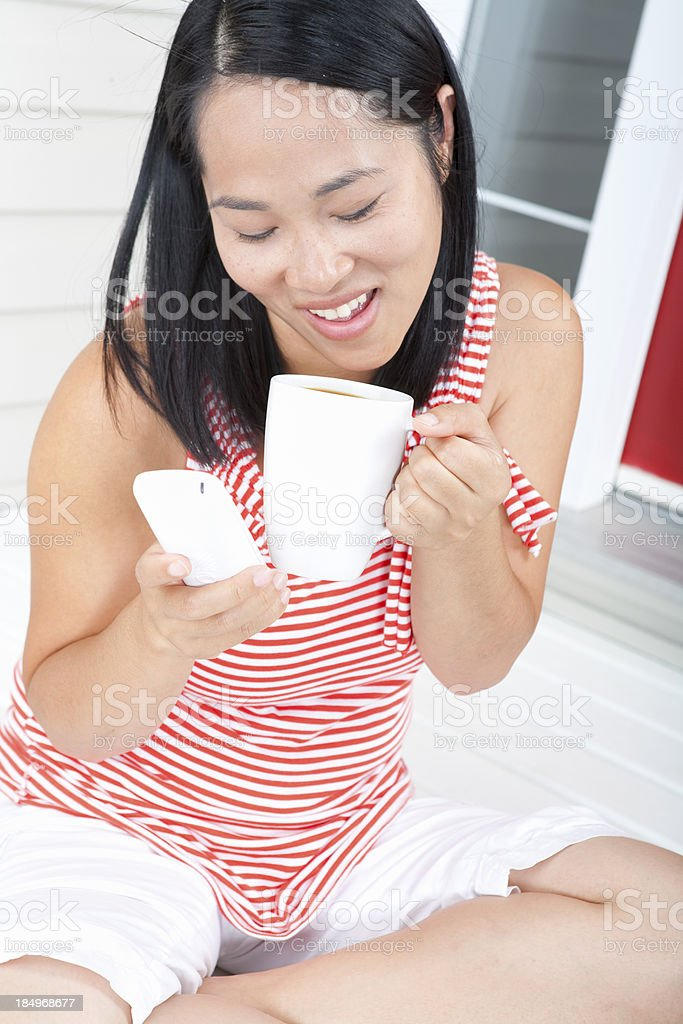 Women drinking coffee and talking on the phone royalty-free stock photo