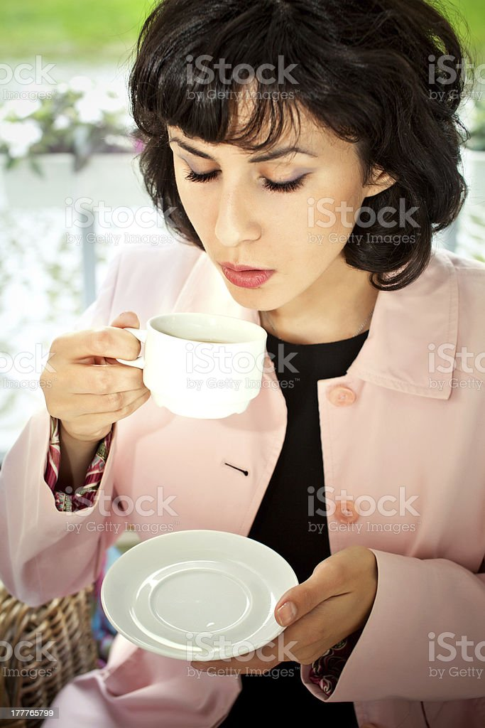 women drinking  coffee or tea smiling royalty-free stock photo