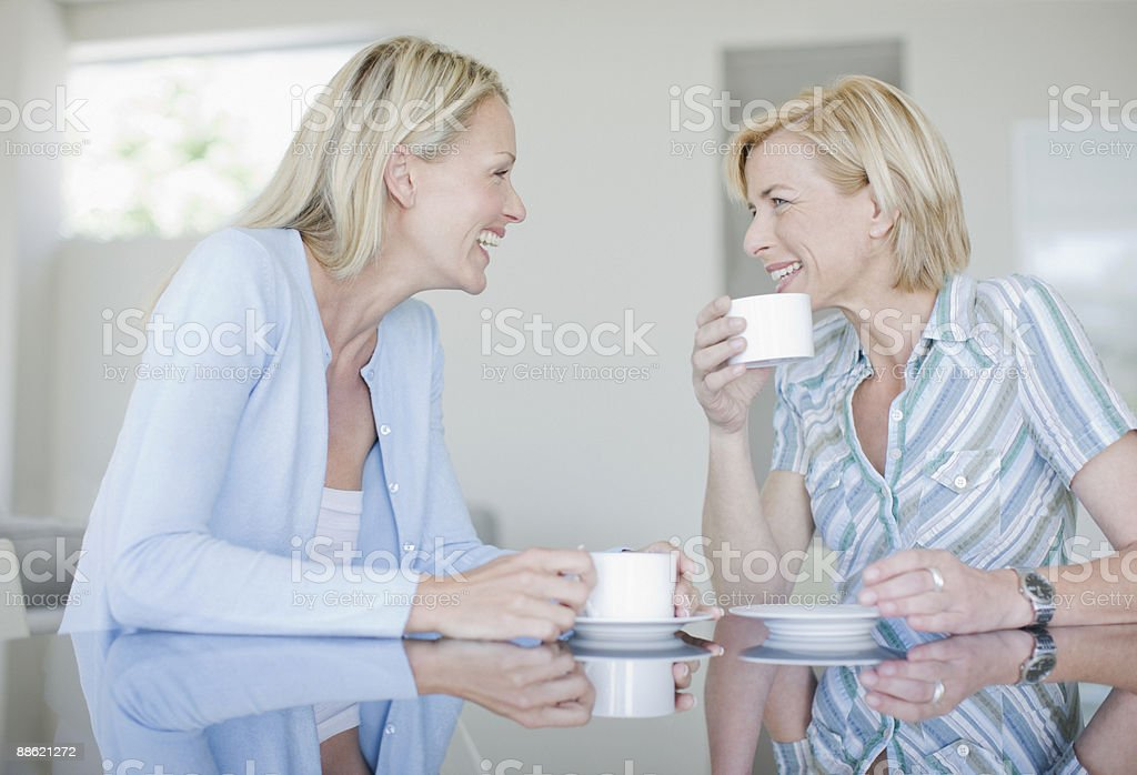 Women drinking coffee together royalty-free stock photo