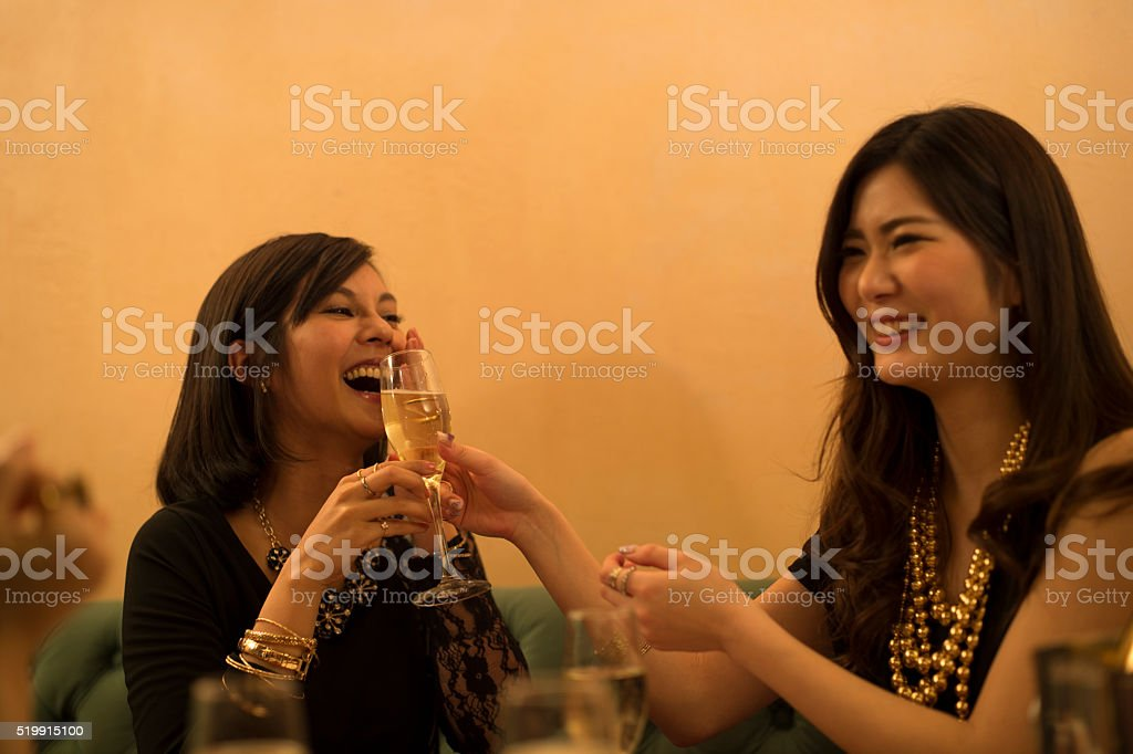 Women drinking delicious champagne stock photo