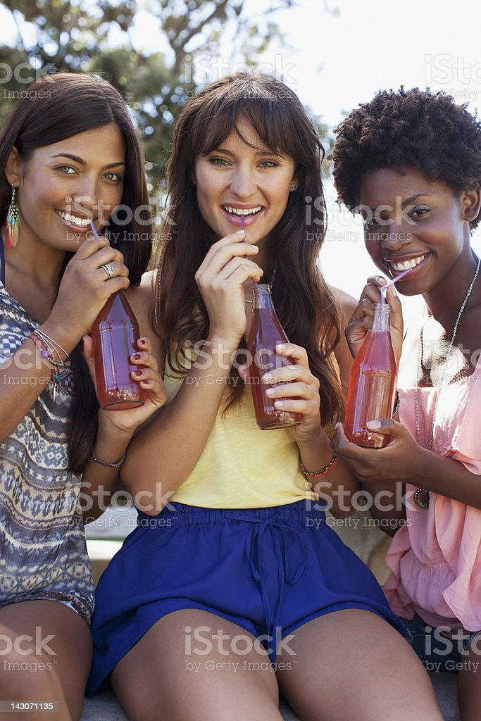 Women drinking soda together royalty-free stock photo