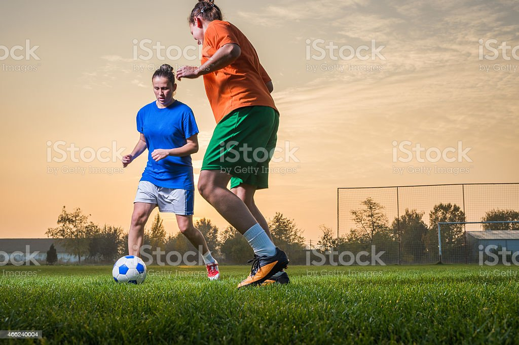 Women during a soccer match at sunset stock photo
